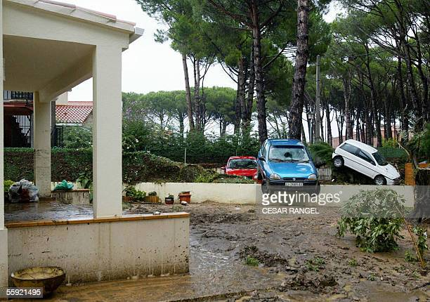 Cars carelessly thrown onto hedges and walls following heavy flooding in Sant Antoni de Calonge 14 October 2005 Four people died in floods in...
