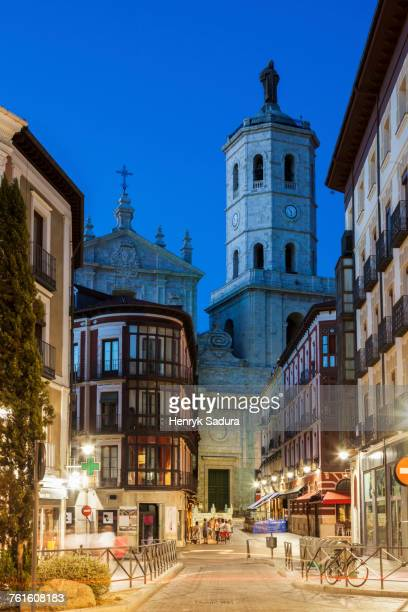 spain, castile and leon, valladolid, city street with cathedral of valladolid in background - valladolid spanish city stock pictures, royalty-free photos & images
