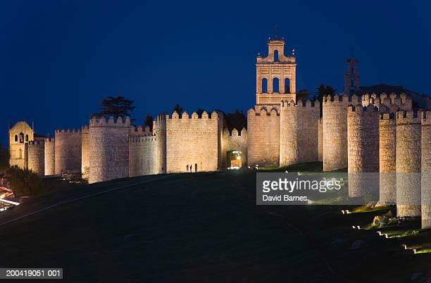 Spain, Castilla y Leon, Avila Province, Avila, fortified walls, dusk