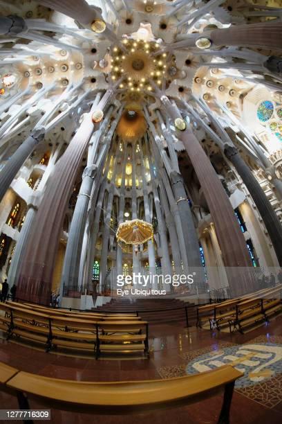 Spain, Catalonia, Barcelona, Interior of the Sagrada Familia designed by Antoni Gaudi, Apse, Altar, Baldachin canopy.