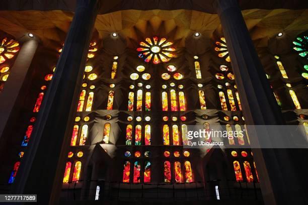 Spain, Catalonia, Barcelona, Interior of the Sagrada Familia designed by Antoni Gaudi, Nave, Passion side, Joan Vila-Grau designed stained glass.