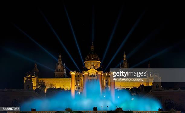 Spain, Catalonia, Barcelona, Night view of Magic Fountain against illuminated Plaza Espana