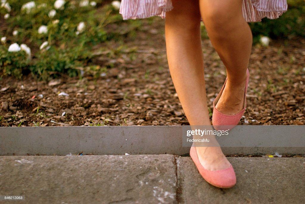 Spain, Catalonia, Barcelona, View of woman's legs in ballerina shoe : Stock Photo