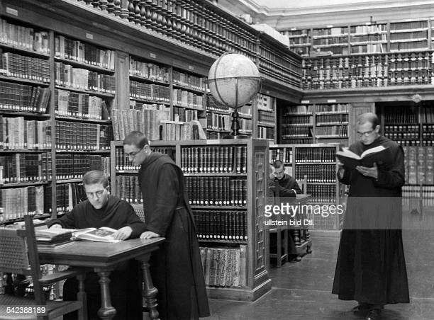 Spain Catalonia Series the life of monks living in the monastery of Montserrat monks in the monastery's library 1931 Photographer Malina Published by...