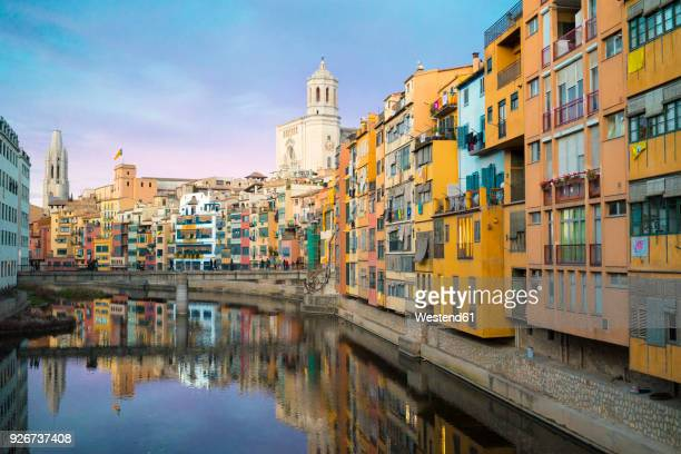spain, catalunya, girona, cathedral and houses along the river onyar in the evening - gerona province stock photos and pictures