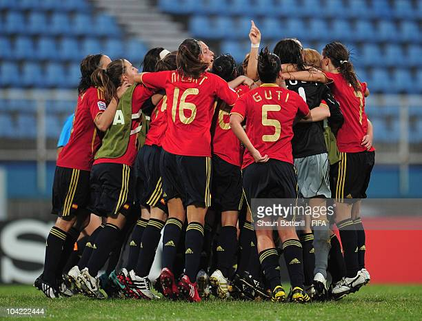 Spain celebrate at the final whistle of the FIFA U17 Women's World Cup Quarter Final match between Spain and Brazil at the Ato Boldon Stadium on...