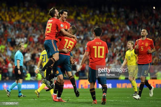 Spain celebrate their third goal during the 2020 UEFA European Championships group F match between Spain and Sweden at Bernabeu on June 10, 2019 in...