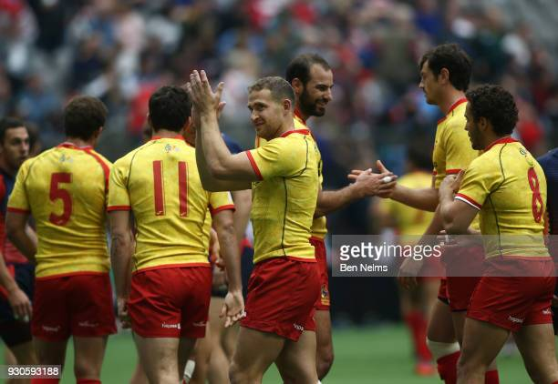 Spain celebrate their win over Russia during the Canada Sevens the Sixth round of the HSBC Sevens World Series at the BC Place stadium Centre on...