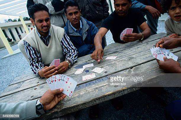 Centro de Estancia Temporal de Inmigrantes CETI in the spanish exclave Migrants play cards
