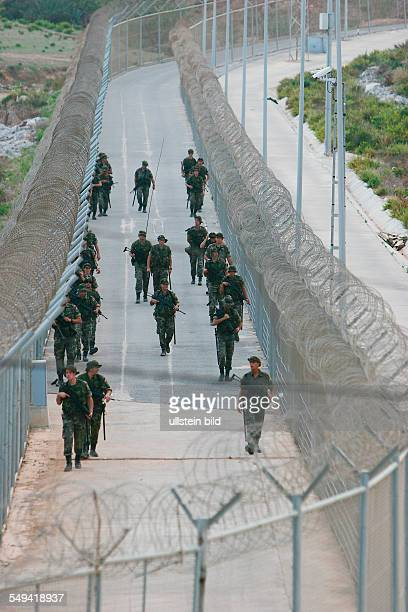 The border fence in the industrial estate The spanish legion or rather the army at the border patrol