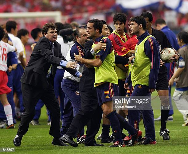 Spain coach Jose Antonio Camacho restrains his players from arguing with referee Gamal Ghandour after the FIFA World Cup Finals 2002 Quarter Finals...