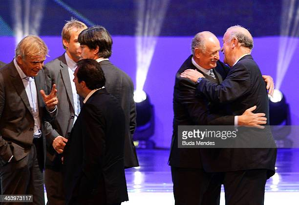 Spain coach Vicente del Bosque greets Brazil coach Luiz Felipe Scolari on stage after the Final Draw for the 2014 FIFA World Cup Brazil at Costa do...