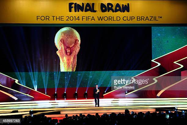 Spain coach Vicente del Bosque holds the World Cup trophy on stage before the Final Draw for the 2014 FIFA World Cup Brazil at Costa do Sauipe Resort...