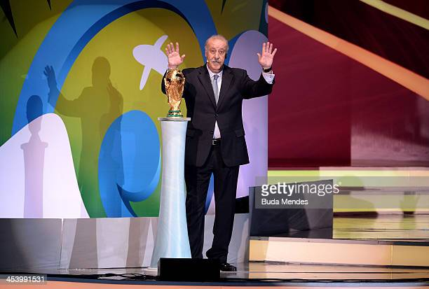 Spain coach Vicente del Bosque places the World Cup trophy on a plinth on stage before the Final Draw for the 2014 FIFA World Cup Brazil at Costa do...