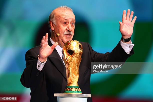 Spain coach Vicente del Bosque speaks to the audience behind the World Cup trophy before the Final Draw for the 2014 FIFA World Cup Brazil at Costa...