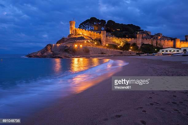Spain, Costa Brava, Tossa de Mar, main beach and old town wall at night