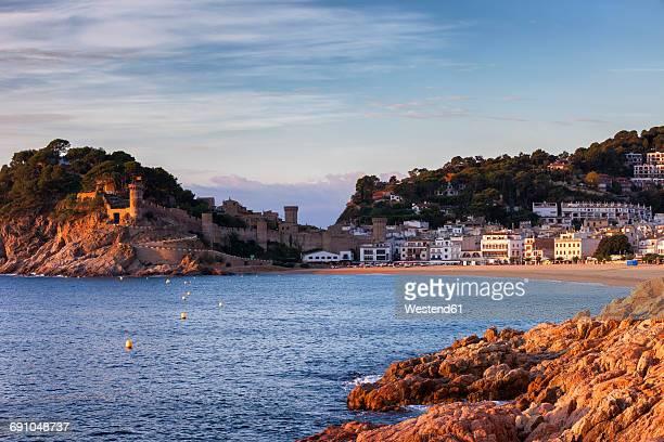 Spain, Costa Brava, Tossa de Mar, town and Mediterranean Sea coast at sunrise