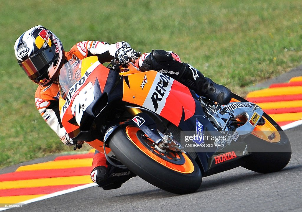 Spain Daniel Pedrosa of Repsol Honda team takes a bend in the MotoGP free practice of the Italian Grand Prix at Mugello track on June 05, 2010. Valentino Rossi of Yamaha fractured his right shin bone in a crash during the free practice, ruling him out of tomorrow's Italian MotoGP. The 31-year-old nine-time world champion - seven of them at this level, comprising six at MotoGp and one at 500cc - had been fastest in practice despite still suffering the effects of a shoulder injury.