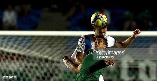 Spain Deportivo de la Coruna's Deak vies for the ball with Colombia Deportivo Cali's Robin Ramirez during their LFP World Challenge friendly football...