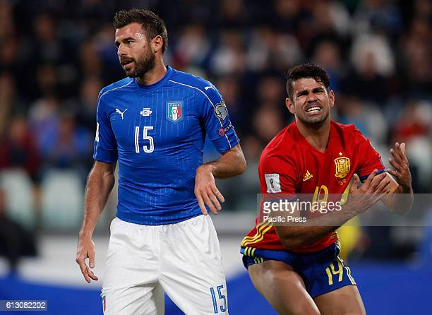 Spain Diego Costa right reacts past Italy Andrea Barzagli during the Fifa World Cup 2018 qualification soccer match between Italy and Spain at the...