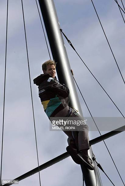 English chef Gordon Ramsey hangs onto the mast of ABN AMRO 2 one of the boats taking part in the Volvo Ocean Race in Sanxenxo 04 November 2005...