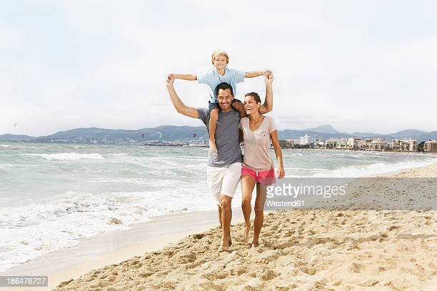 Spain, Family walking on beach at Palma de Mallorca