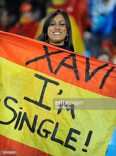 Spain fan holds up a Spanish flag with a message to Xavi of Spain before the start of the 2010 FIFA World Cup South Africa Group H match between...