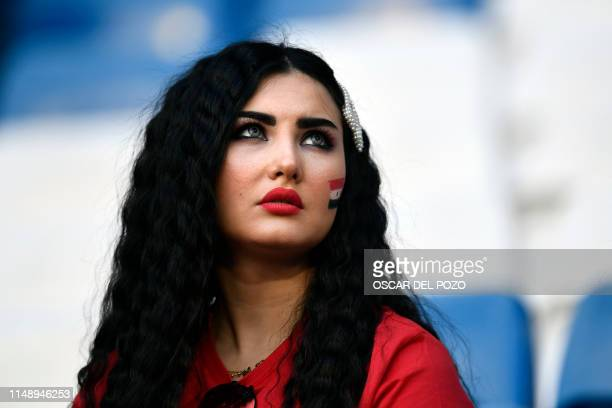 A Spain fan waits for the start of the UEFA Euro 2020 group F qualifying football match between Spain and Sweden at the Santiago Bernabeu stadium in...