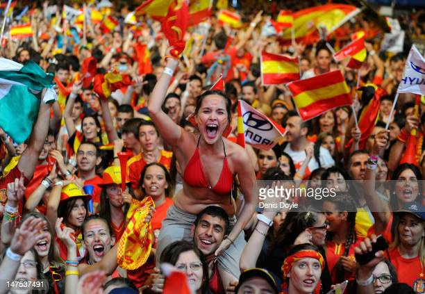 Spain fans celebrates the UEFA EURO 2012 final match between Spain and Italy on a giant outdoor screen on Paseo de la Castellana on July 1 2012 in...
