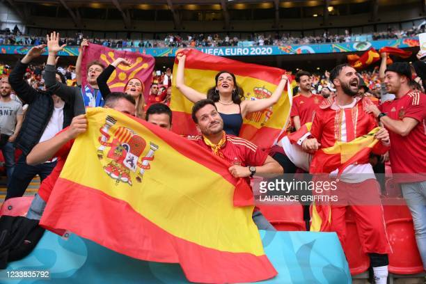 Spain fans cheer before the start of the UEFA EURO 2020 semi-final football match between Italy and Spain at Wembley Stadium in London on July 6,...