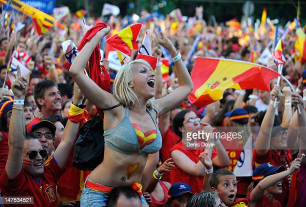 Spain fans watch the UEFA EURO 2012 final match between Spain and Italy on a giant outdoor screen on Paseo de la Castellana on July 1, 2012 in...