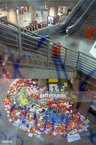 Flowers and candles have been displayed at Atocha train station on the eve of the general election in Spain and two days after rail bombings which...