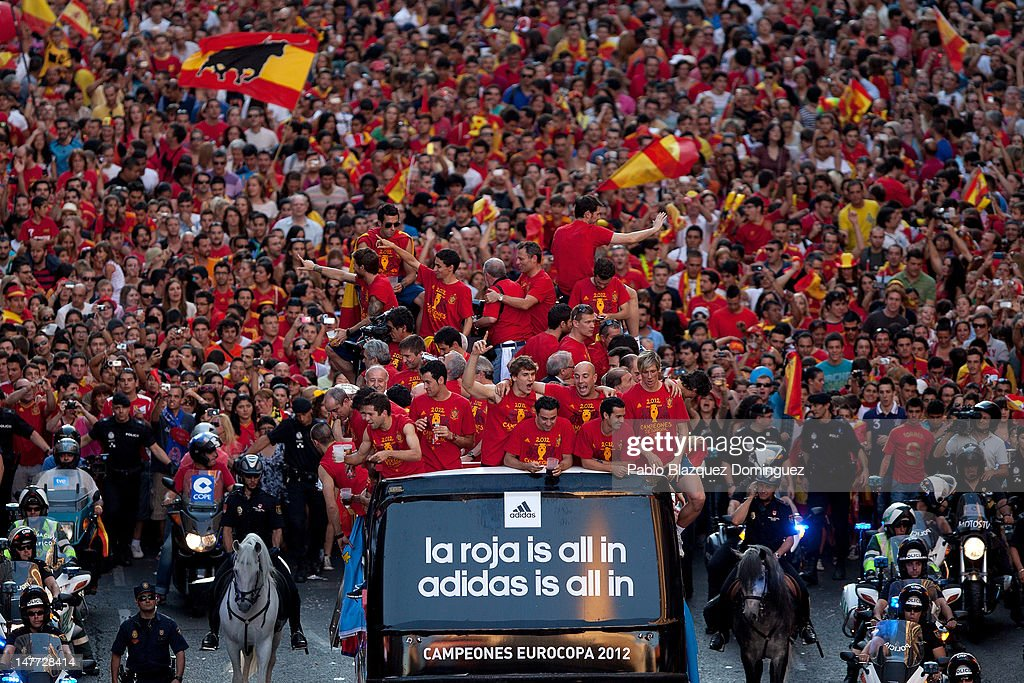 Spain Football team players celebrate with the UEFA EURO 2012 trophy on a double-decker bus during the Spanish team's victory parade on July 2, 2012 in Madrid, Spain. Spain beat Italy 4-0 in the UEFA EURO 2012 final match in Kiev, Ukraine, on July 1, 2012.