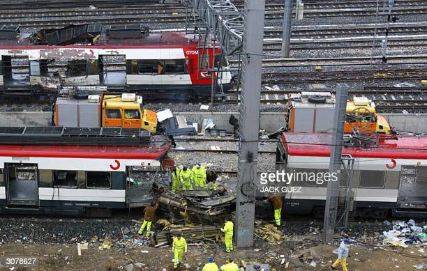 Forensic experts inspect the trains before moving them 12 March 2004 at the Atocha train station At least 198 people were killed and more than 1400...
