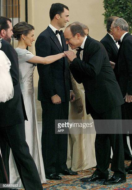 Former journalist Letizia Ortiz welcomes Prince Albert of Monaco before an official dinner at the Pardo Palace 21 May 2004 on the eve of her wedding...