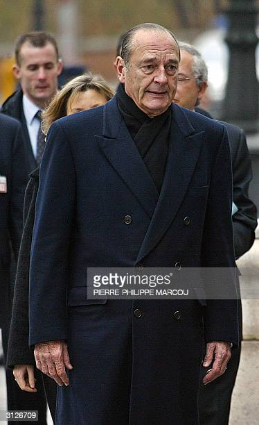 French president Jacques Chirac arrives at the Almudena Cathedral to attend the memorial mass for the 190 identified victims of the March 11 train...