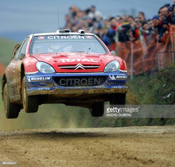 French World Rally champion driver Sebastian Loeb jumps in his citroen during an exhibition event in Cartes 15 December 2005 Loeb was competing in...