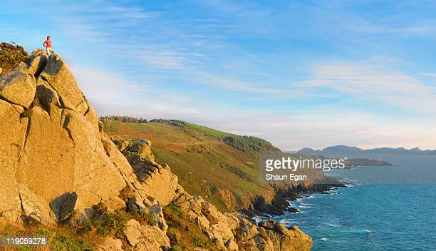 Spain, Galicia, Cangas, woman looking over sea.