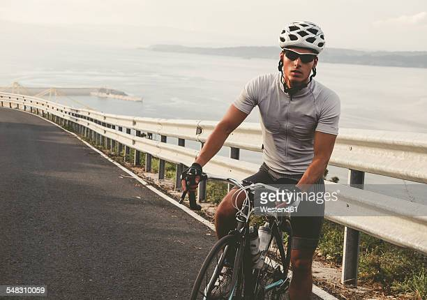 spain, galicia, ferrol, cyclist on the road - cycling event stock pictures, royalty-free photos & images