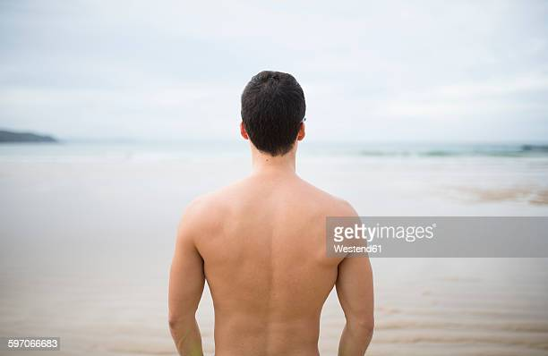 Spain, Galicia, Ferrol, shirtless man looking on the sea