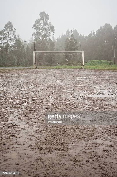 Spain, Galicia, Valdovino, muddy soccer field on a rainy day