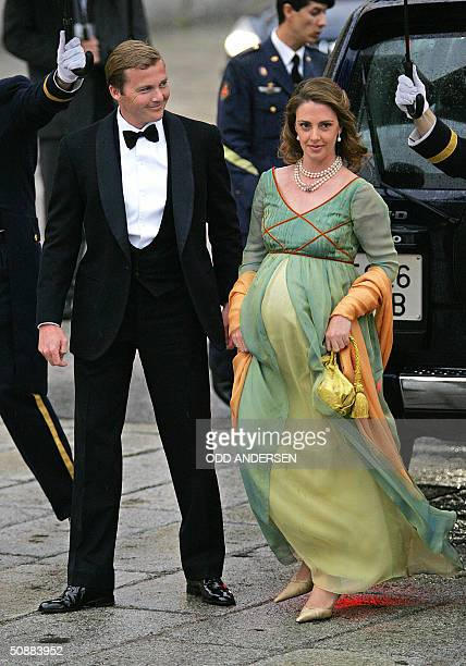 German Gustav zu Sayn-Wittgenstein and an unidentified person arrives to attend an official diner at the Pardo Palace in Madrid 21 May 2004 on the...
