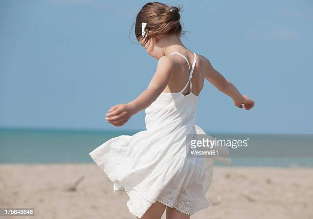 Spain, Girl playing on beach