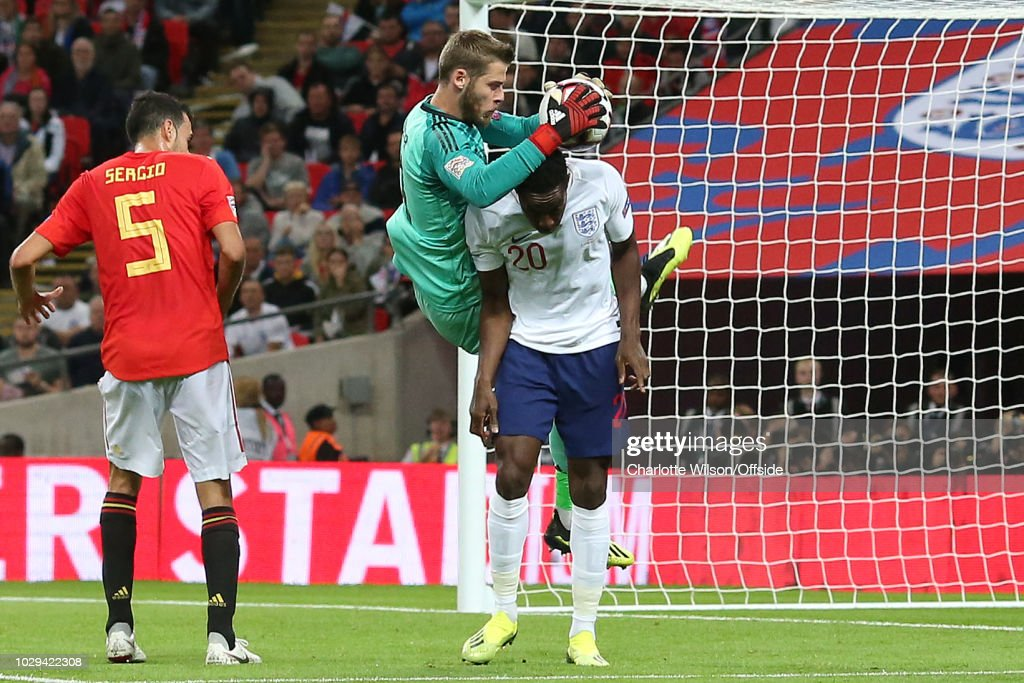 Spain goalkeeper David De Gea comes down on Danny Welbeck of England after making a save during the UEFA Nations League A group four match between England and Spain at Wembley Stadium on September 8, 2018 in London, United Kingdom.