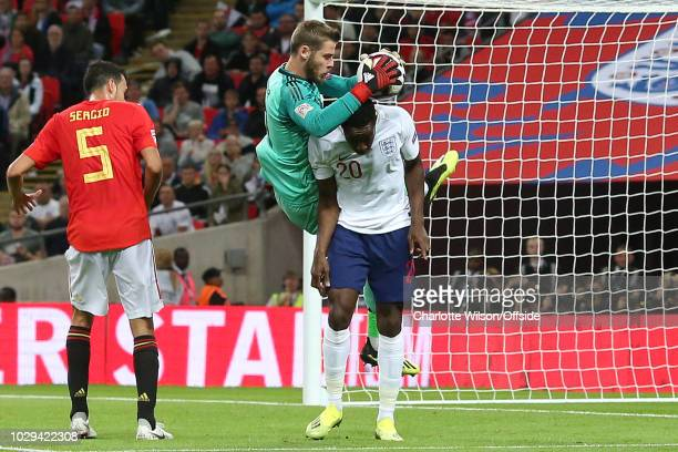 Spain goalkeeper David De Gea comes down on Danny Welbeck of England after making a save during the UEFA Nations League A group four match between...
