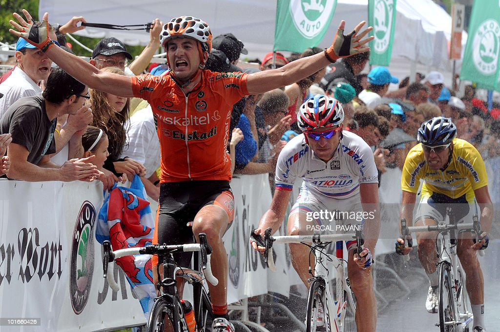 Spain Gorka Izaguirre (L) celebrates as he crosses the finish line ahead of Russia's Sergei Ivanov (C) and Italian yellow jersey Matteo Carrara (r) during the 'Tour of Luxembourg' last stage on June 6, 2010 in Luxembourg. Izaguirre won the stage as Matteo Carrara won the race ahead of Luxembourg's Franck Schleck and Lance Armstrong.