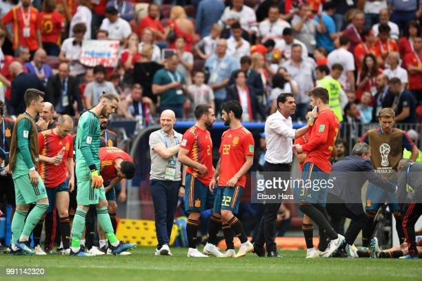 Spain head coach Fernando Hierro speaks to his players during the 2018 FIFA World Cup Russia Round of 16 match between Spain and Russia at Luzhniki...