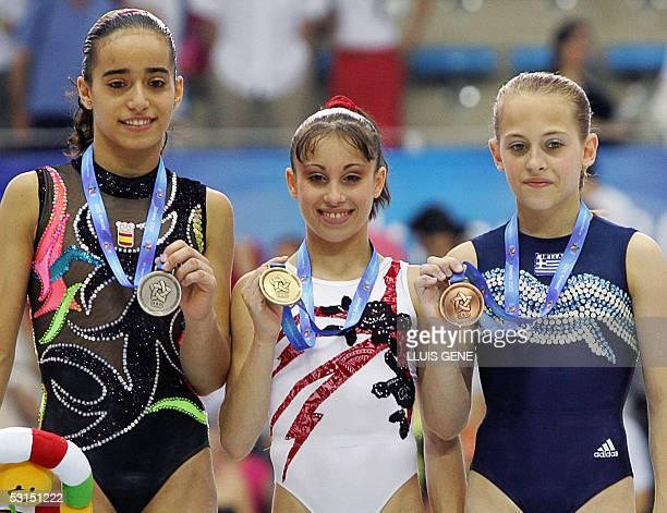 Italian Vanessa Ferrari Spanish Tania Gener Cordero and Greek Stefani Bismpikou show their medals after the gymnastic women's allaround final of the...