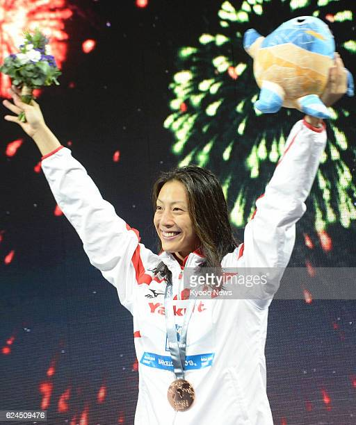 BARCELONA Spain Japan's Aya Terakawa at the award ceremony acknowledges cheers with the bronze medal she won in the women's 50meter backstroke at the...