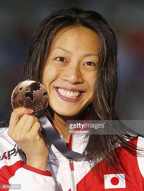 BARCELONA Spain Japan's Aya Terakawa at the award ceremony shows the bronze medal she won in the women's 50meter backstroke at the world swimming...
